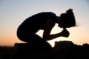 praying on her knees